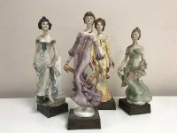 A set of four limited edition Albany fine china Art Nouveau series figures depicting ladies in flowing dresses, height 31.5 cm. (4)