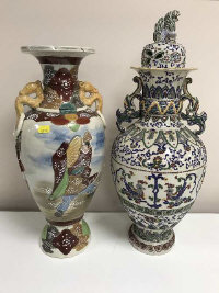 Two early twentieth century Japanese stoneware vases, (one lidded), height 48.5 cm. (2)