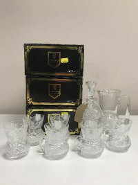 Edinburgh Crystal - A miniature decanter, six punch glasses and water jug,  (three boxes).(8)
