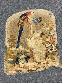 A 19th century embroidery section - Terrier at play.