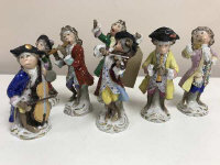 A group of seven Sitzendorf monkey band players, height 14 cm. (7)