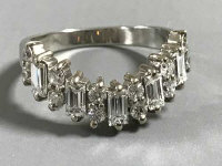 A platinum ring set with baguette and round diamonds, approximately 1ct, size N/O.