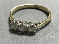 An 18ct gold old cut three stone diamond ring, approximately 0.45ct, size L, 2g.