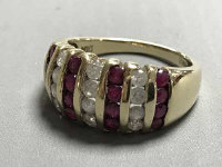 A 9ct gold ruby and diamond set ring, size N/O, 5g.