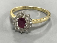 An 18ct gold ruby and diamond cluster ring, size N/O.