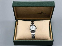 A Rolex Lady's Oyster Perpetual stainless steel wrist watch, with white dial, spare link, guarantee paper and box.