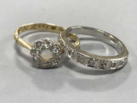 A white gold diamond half eternity ring and an 18ct gold diamond and opal cluster ring