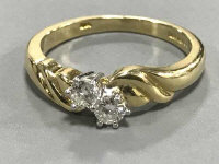 An 18ct gold two-stone diamond ring, approximately 0.2ct, size M/N.