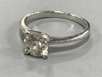 A platinum diamond solitaire ring, approximately 0.72ct, size H.