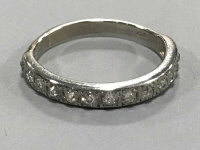 An 18ct white gold diamond half eternity ring, approximately 0.75ct.