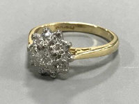 An 18ct gold diamond cluster ring, size I