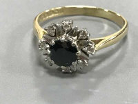 An 18ct gold diamond and sapphire cluster ring
