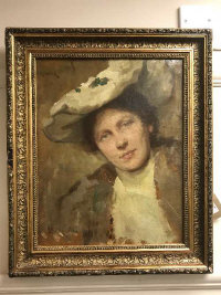 Simon Glucklich (1863-1943) : A portrait of a lady wearing a white bonnet, oil on canvas, signed, 34 cm x 44.5 cm, framed.