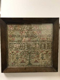 An early 19th century tapestry sampler, dated 1824, 33 cm x 31 cm, in rosewood frame.