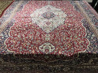 An Isfahan design carpet on red ground 330 cm x 240 cm.
