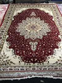 An Isfahan design rug on red ground, 230 cm x 160 cm.