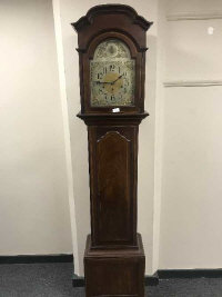 A late nineteenth century inlaid mahogany longcased clock with silvered dial