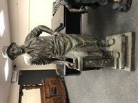 A large bronze statue - The Blacksmith with hammer, height 200 cm.