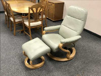 A green leather Himolla relaxer chair and stool. (2)