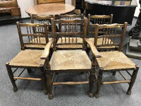 A set of six early twentieth century oak rush seated country chairs. (6)