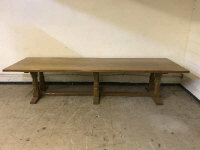 An impressive Robert 'Mouseman' Thompson of Kilburn 11ft adzed oak five-plank refectory dining table, 336 cm x 105 cm, on triple double-pillared supports with under-stretcher. (Viewing by appointment please consult a member of staff).