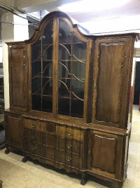 An eighteenth century style continental mahogany break fronted display cabinet on claw and ball feet, width 217 cm.  (Viewing by appointment please consult a member of staff)