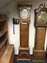 An antique continental pine gilded long case clock, height 203 cm