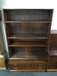A mid 20th century rosewood bookcase, fitted with two drawers below, width 100 cm