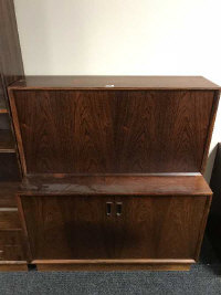 A mid 20th century rosewood fall front cabinet, fitted with double doors below, width 100 cm