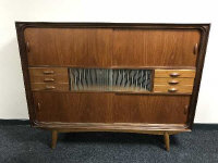 A mid 20th century teak multi drawer sideboard, with sliding panel doors, width 154 cm