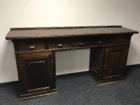 An early 20th century stained pine multi drawer clerk's desk, width 225 cm
