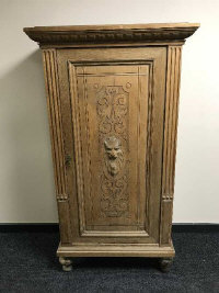 A late 19th century oak carved panelled side cabinet, width 91 cm