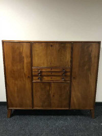 A mid 20th century mahogany sideboard, fitted with cutlery drawers and panel doors, width 152 cm