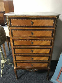 An early 20th century inlaid mahogany and ormolu mounted narrow six drawer chest, width 60 cm