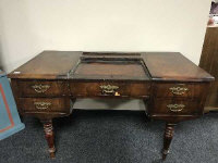 A 19th century mahogany desk fitted with five drawers on turned legs, width 132 cm