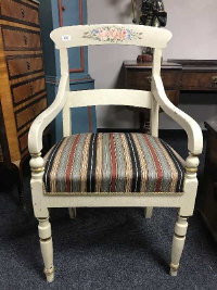 A 19th century painted open armchair, with striped fabric cushion, width 54 cm