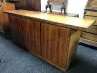 A Danish rosewood low sideboard by Skovby, with fitted interior and enclosed by three panel doors, width 190 cm