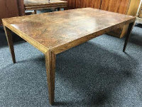 A mid 20th century Danish rosewood low table, on square tapered legs, 75 cm x 134 cm