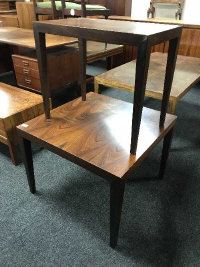 A Danish rosewood square coffee table, on square tapered legs, 66 cm x 66 cm together with another small table similar (2)