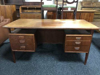 A mid 20th century teak desk fitted with six drawers, width 145 cm