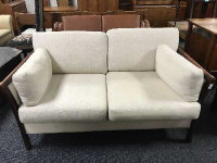 A continental two seater settee upholstered in oatmeal fabric by Friis, width 144 cm