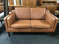 A mid 20th century continental brown leather two seater settee, width 136 cm