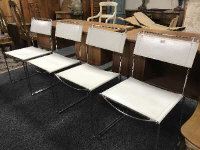 A set of four mid 20th century steel and white leather stitched dining chairs, width 45 cm each.