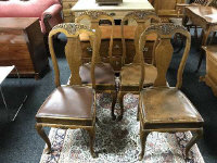 A set of four Queen Anne style oak dining chairs (4)