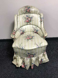 A 19th century bedroom chair, with shaped back, upholstered in floral fabric, width 61 cm