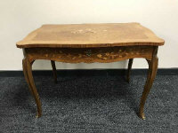 A Dutch marquetry style inlaid walnut low table, fitted with a drawer, with shaped top, width 50 cm