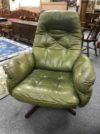 A mid 20th century green leather relaxer chair, by Gote-Mobler, made in Sweden, height 96 cm.