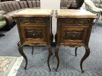A pair of French walnut marble topped bedside stands, height 84 cm. (2)