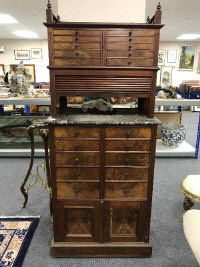 A late Victorian multi drawer horologist's cabinet with shutter front above marble work stand, width 71.5 cm.