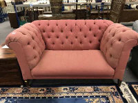 A late Victorian buttoned drop end settee, upholstered in pink fabric, width 157 cm.